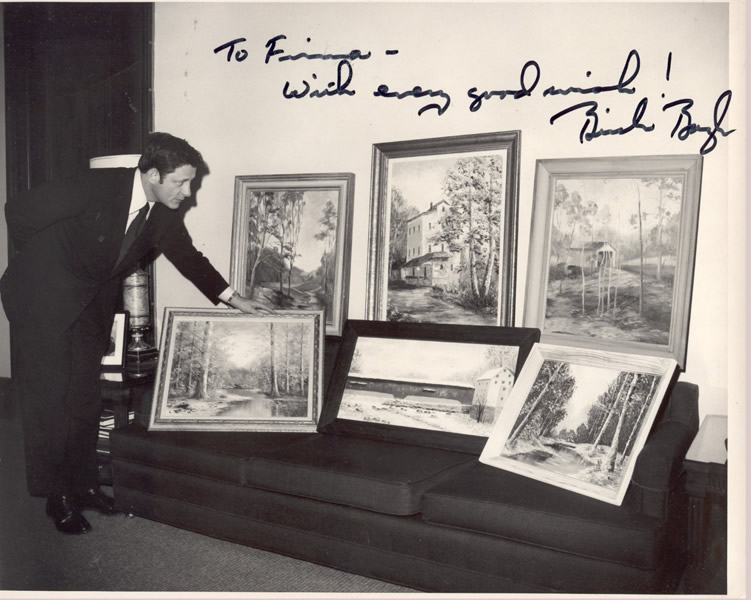 Senator Birch Bayh with one of Aunt Firma's Paintings (and several other artists'